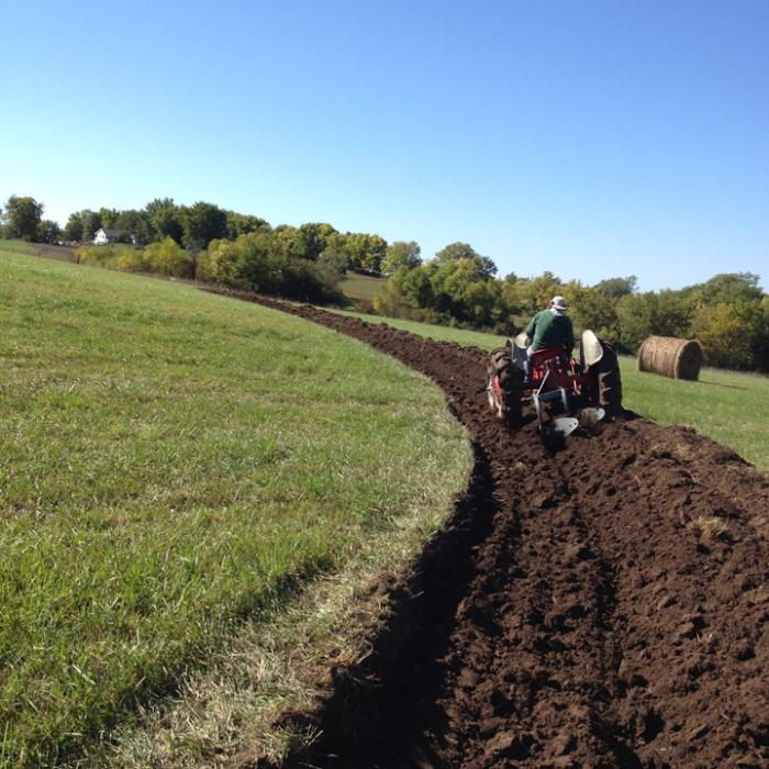 Building water catchment swales with a tractor